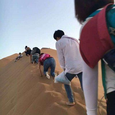 Walking up the dune.