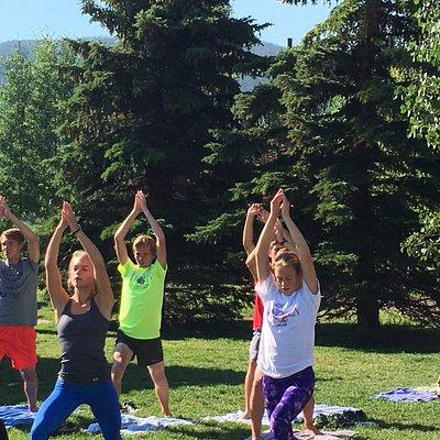 South Dakota cross country team enjoying Yoga at the Marina with Lauren Brand
