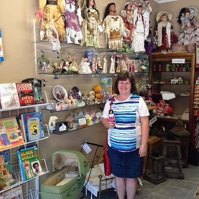Loretta in the gift shop with her traveling doll.