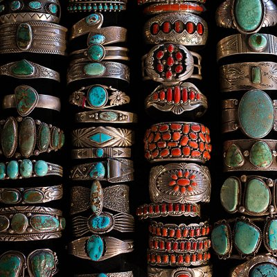 Turquoise and coral cuffs, all in sterling silver.
