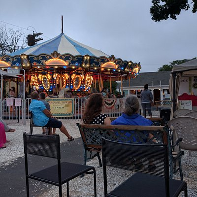 Gorgeous summer night at the carousel with live music.