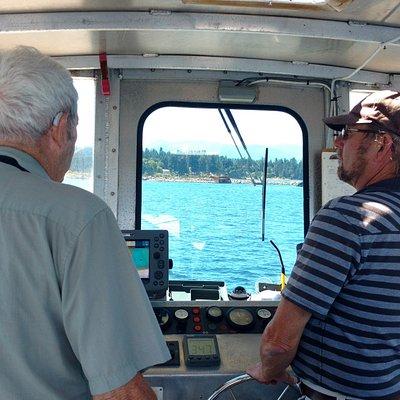 Dad & Cap'n Dan deep in discussion