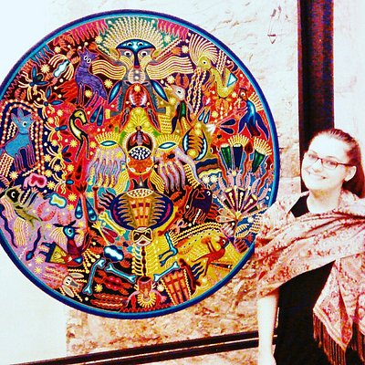 This is fiber art by the Huichol people.