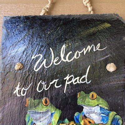 """Welcome"" sign hand painted on slate roof tile."