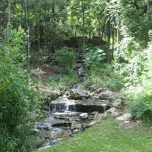 A lovely waterfall at the edge of the parking lot.