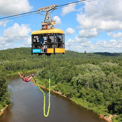 The jumps are organized from areal cable car over Gauja River in National park