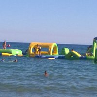 Inflatables in the sea on Calafell Beach