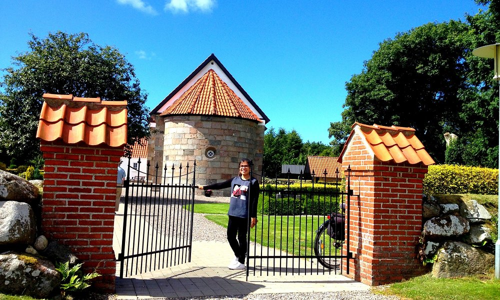 The entrance gate and the church in the background.