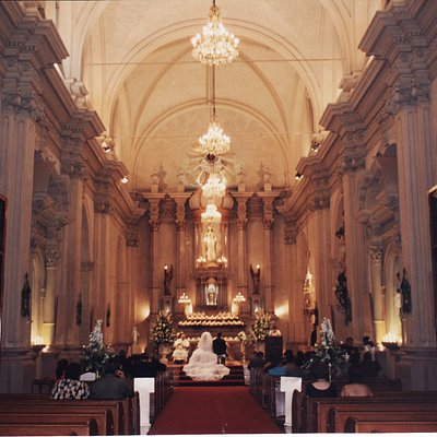 An inside view of the church and its beautiful chandeliers
