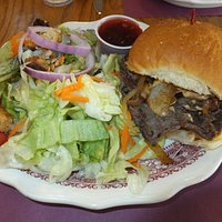 Shaved Steak and Onions Sandwich with side salad