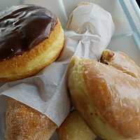 Custom donuts , deep-fried sufganiyot filled with strawberry jelly and more