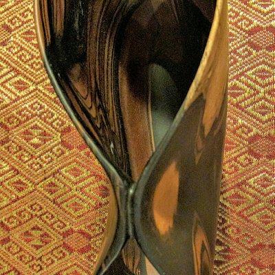 Black/White Ebony with silver trim. Red/White Ebony puckered bowl.