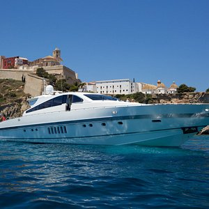 89' Arno Leopard yacht, Disco Volante, with Ibiza Town in the background