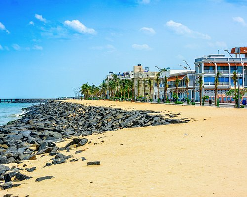 Beautiful Buildings the sky beach and sea in a hot afternoon at Rock Beach, Pondicherry