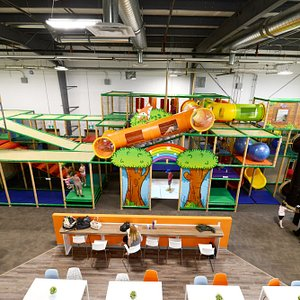 A view of the concession seating and the interactive play floor in the middle of the playground.