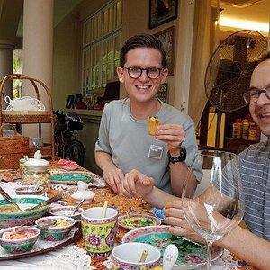 Guests enjoying kueh pie tee - they had so much fun preparing them!