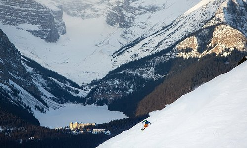 Skiing the Lake Louise Ski Resort with Lake Louise in the background