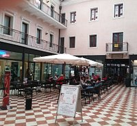 Cafè exterior and outside seating in Galleria Braghin