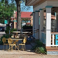 Outdoor seating on the porch or some tables in the yard