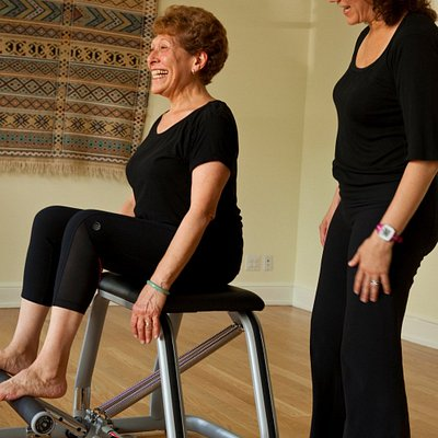 Practicing Pilates on the Wunda Chair at New Leaf Yoga & Pilates