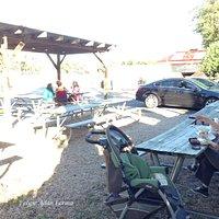 Ample picnic tables set beyond drive-through at Sandy's Hamburgers.