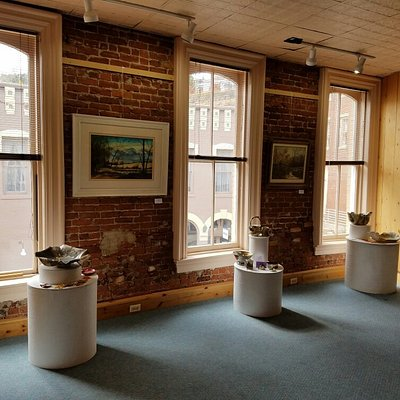 There is an art gallery featuring local artists upstairs.