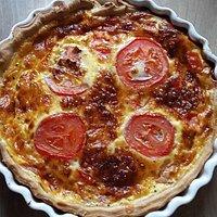Delicious cheese and tomato quiche