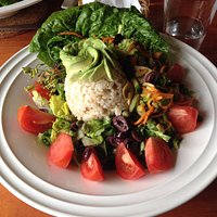 A tasty veggie salad served with with brown rice