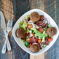 Our Greek Salad topped with our famous Felafels