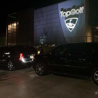 2 of our matching Caslliac Escalades at Top Golf for a corporate outing