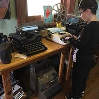 Typewriters and old phones for kids to explore.