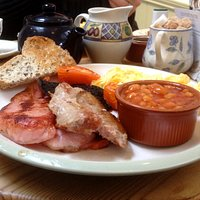 Gluten-free full English breakfast, including toast, sausage and beans