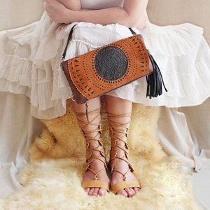 Classic moments in Carrie clutch; hand tooled cut outs. Aurora flats in tan.