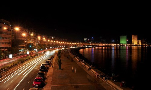 Marine drive seen as an arch of light at night.