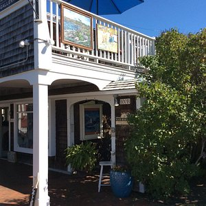 Perkins Cove Gallery is located upstairs, on the balcony overlooking the drawbridge in Perkins C