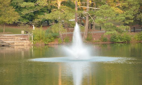 Water fountain in the middle of lake.
