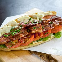 B.L.T  Crisp smoked bacon, greens, grilled tomato, lashings of mayo served on French baguette