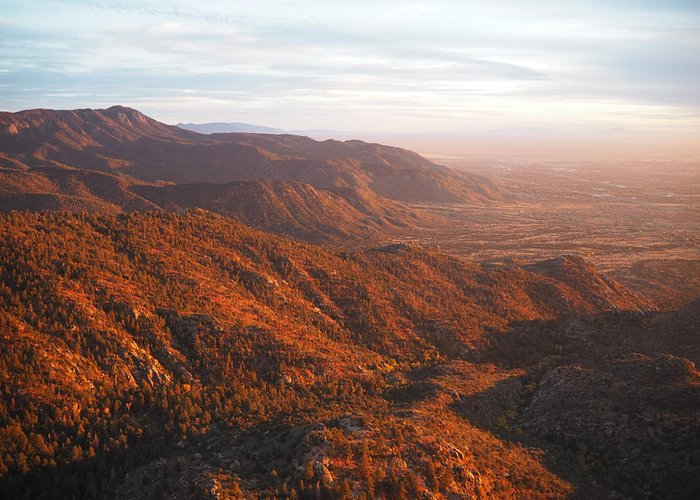 View on Sandia Mountain from Sandia Tramway cabin, while we were descending during sunset.