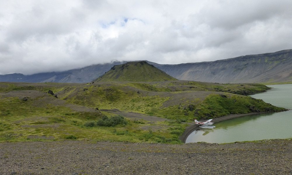 Surprise Lake in caldera of volcano, shows the little plane we flew in