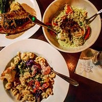 Truffle cauliflower mac n cheese, seafood pasta, and colorado sea bass over polenta