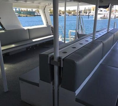 Lower outdoor deck with upholstered seats for cruises