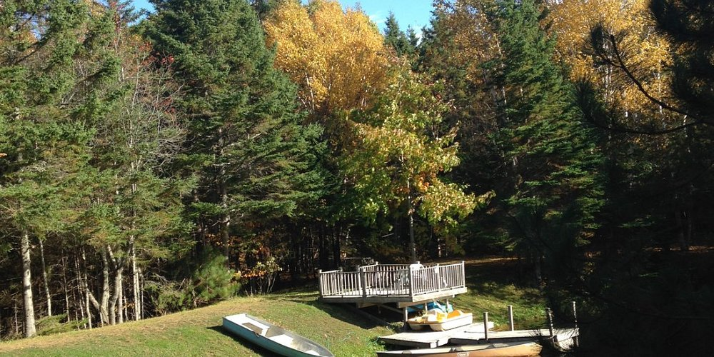 Private access to lake, with kayaks, boats, cano, dock and deck