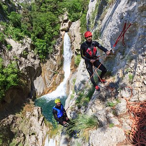 Rappelling down the 55m cliff on our Extreme Canyoning tour...