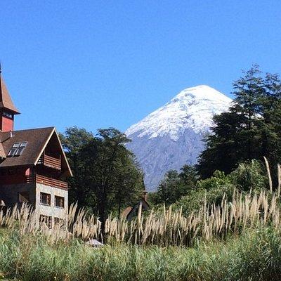 Quaint architecture, imposing volcano