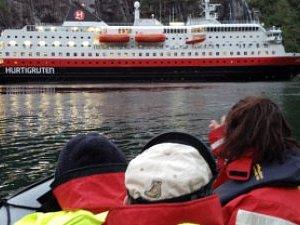 Meet the «Hurtigruten» inside the Troll Fjord.