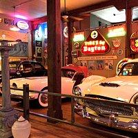 Tons of cars, gas pumps, signs - pop culture!