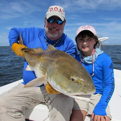 Capt. Gary and Shelby with a Neuse River giant red drum