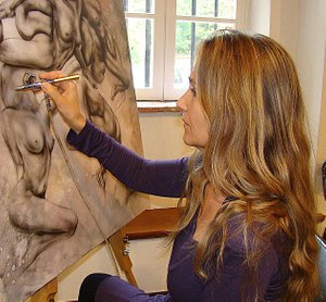 The artist, Mistral-Melike, working on a painting.