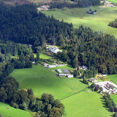 Aerial view of Logie House, and Logie Steading by the river Findhorn