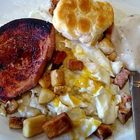 Fried bologna, biscuits & gravy, potatoes, and over easy eggs!